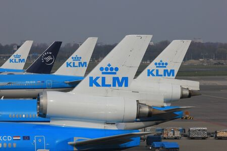 just arrived: March, 24th, Amsterdam Schiphol Airport Planes on the gate, waiting to depart or just arrived, tail details
