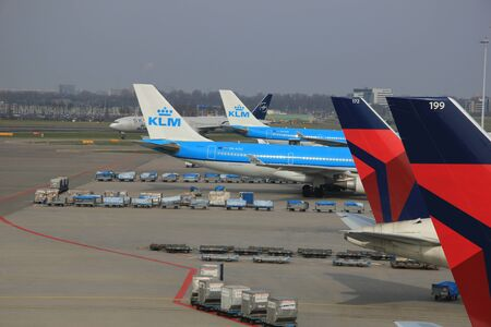 schiphol: March, 24th, Amsterdam Schiphol Airport Planes on the gate, waiting to depart or just arrived Editorial