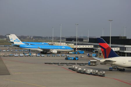 just arrived: March, 24th, Amsterdam Schiphol Airport Planes on the gate, waiting to depart or just arrived Editorial