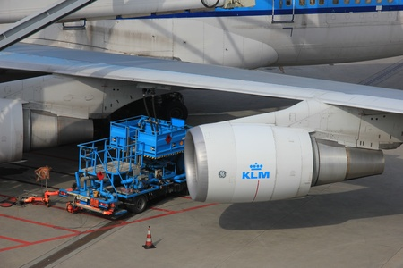 fueling: March, 24th, Amsterdam Schiphol Airport, an airplane gets its fuel from an underground fueling system