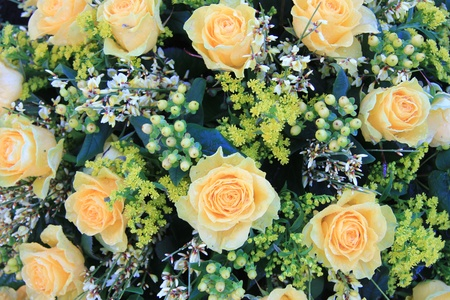 a bouquet with pale yellow roses and some green decorations Stock Photo - 13008682