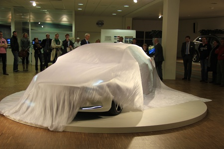 white sheet: March 31st, Beesd the Netherlands Presentation of new Volvo V40, car covered with white sheet on display in showroom Editorial