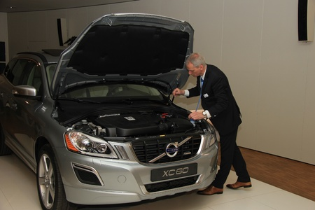 sales person: March 31st, Beesd the Netherlands Presentation of new Volvo V40,Volvo XC 60 in showroom, sales person checking battery Editorial