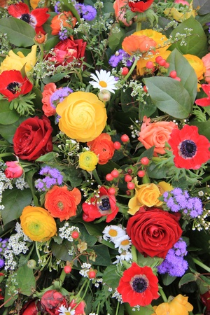 Different spring flowers combined with gerberas and carnations photo