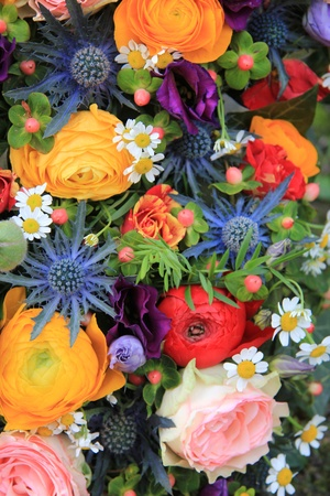 Summer flower arrangement in many bright colors photo