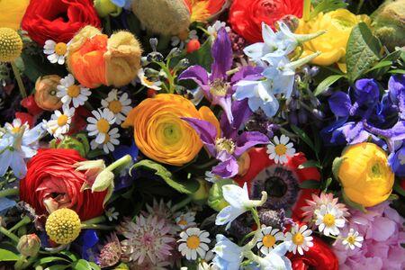 Wildflower arrangement in bright colors, various flowers photo