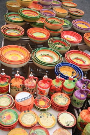Colorful, traditional pottery on a market in the Provence, France photo