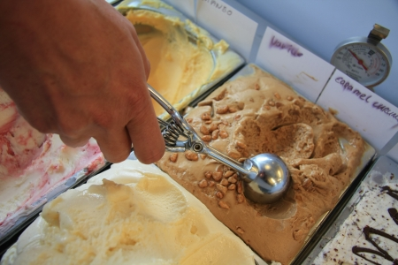 Woman scooping ice cream in a shop photo
