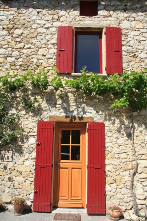 House in typical provencal style in France, windows with wooden shutters Stock Photo - 13682285