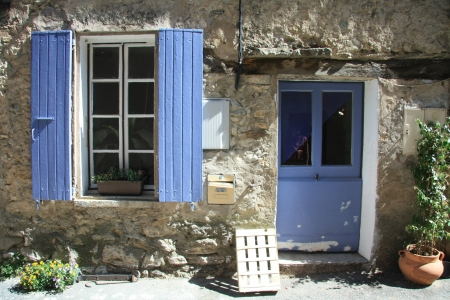 House in typical provencal style in France, windows with wooden shutters