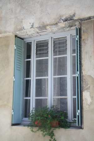 Window of an old house in the Provence, France photo