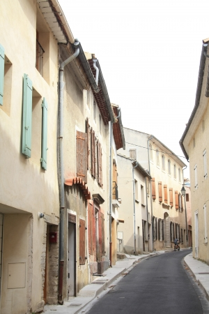 Narrow street in a small village in the Provence, France photo