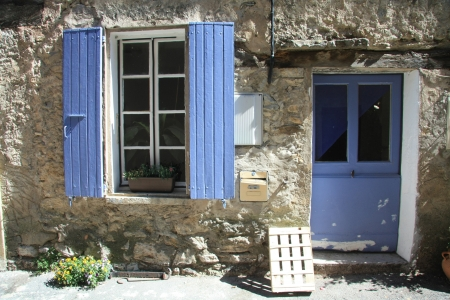 House in typical provencal style in France, windows with wooden shutters photo