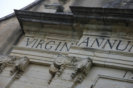 Inscription in latin on the facade of a medieval church in the Provence, France photo