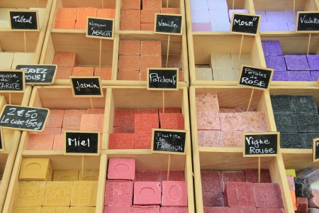 Bars of soap in many different colors on a market in the Provence, France Stock Photo