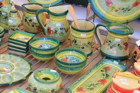 Pottery in many bright colors on a local market in the Provence, France Stock Photo - 14138264