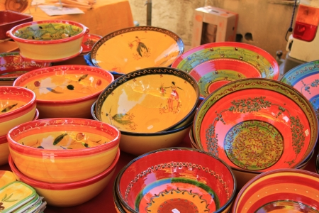 Pottery in many bright colors on a local market in the Provence, France Stock Photo - 14138427