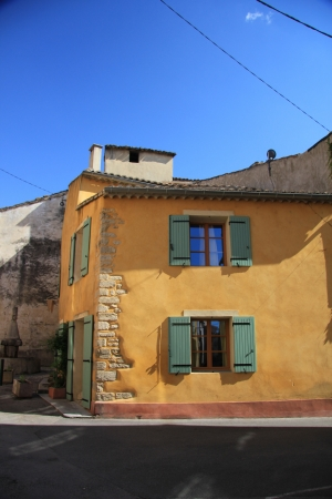 House in the Provence, France. Wooden painted shutters