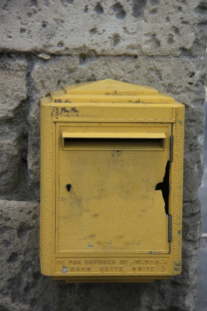 Old yellow mailbox in France, postal service photo