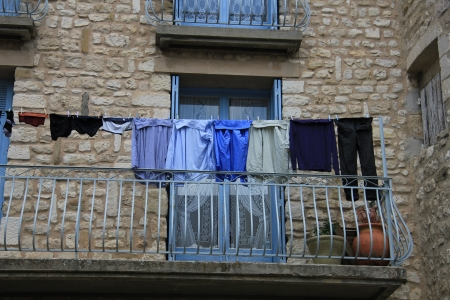 Blue laundry on a balcony in France photo