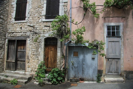 Ancient houses in the Provence. Typical wooden shutters and stone facades photo