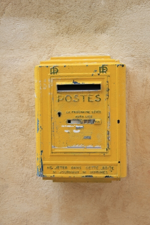 postes: Old yellow mailbox in France, postal service