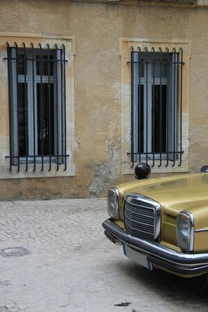 Vintage car in front of old building photo