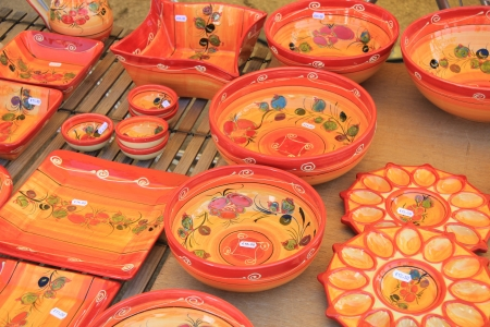 Handmade colorful pottery on a market in the Provence