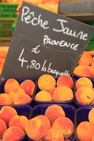 Big juicy peaches on a french market Stock Photo - 14129899