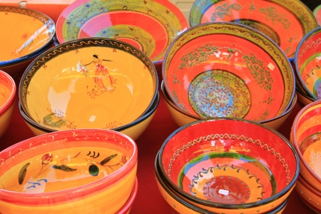 Pottery in many bright colors on a local market in the Provence, France Stock Photo