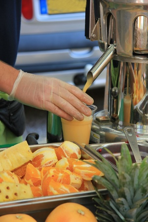 Juice bar or vitamin bar on a market in France, different sorts of fresh juice Stock Photo - 14103897