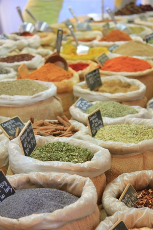 Herbes and spices in jute bags on a Provencal market in France photo
