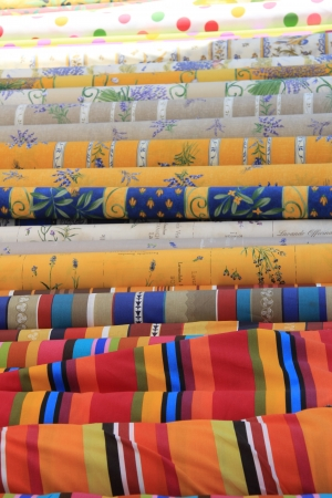 Traditional Provencal patterns on rolls of cotton on a local market Stock Photo