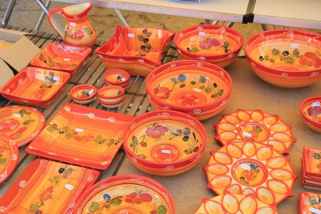 Handmade colorful pottery on a market in the Provence photo