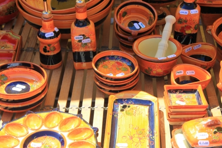 Pottery in many bright colors on a local market in the Provence, France photo