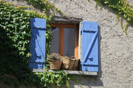 Window of a house in the Provence, France photo