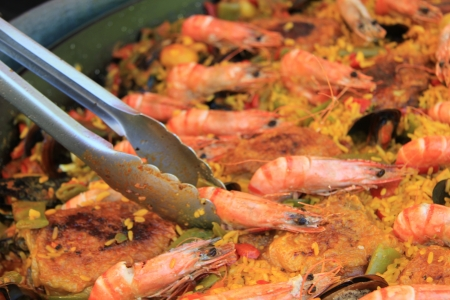 Fresh made Paella on a french market photo