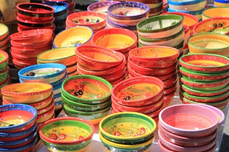 Handmade colorful pottery on a market in the Provence Stock Photo - 14340708