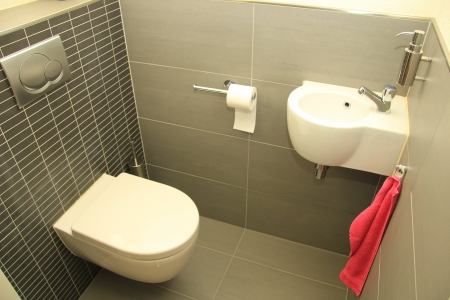 Modern toilet in white and different shades of grey photo