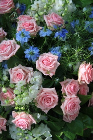 Flower arrangement in blue and pink, roses and love in a mist photo