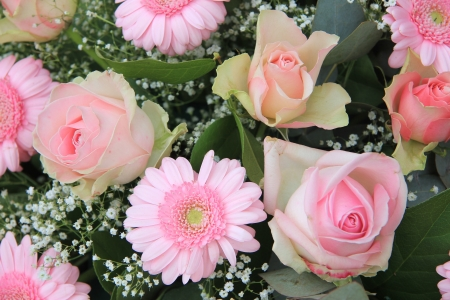 pale pink gerberas and roses in mixed flower arrangement