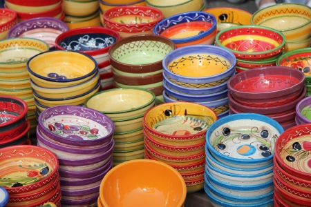 Pottery in various bright colors, traditional patterns from the Provence photo