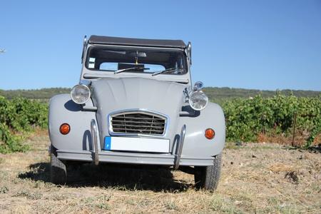 horsepower: Grey Vintage French car in a vineyard