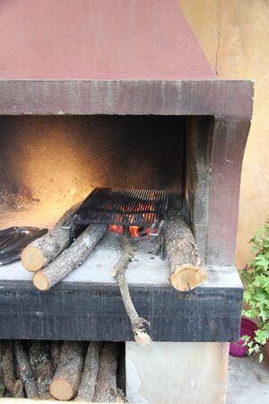 Traditional wood stove with a burning fire photo