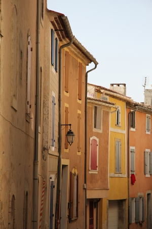 yellow  ochre: Colored houses with plastered facades in Bedoin, France Stock Photo
