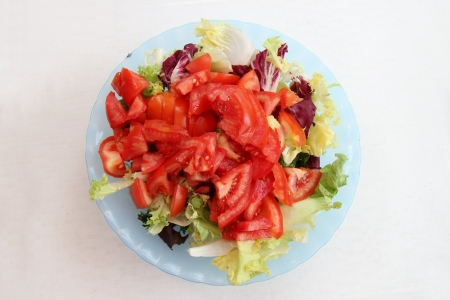 Fresh salad with tomatoes in a bowl photo