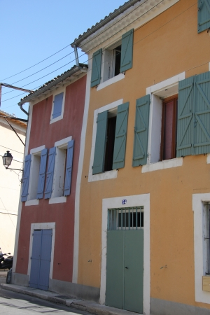 Traditional Provencal houses with plastered facades in bright colors in L'Isle sur la Sorgue photo