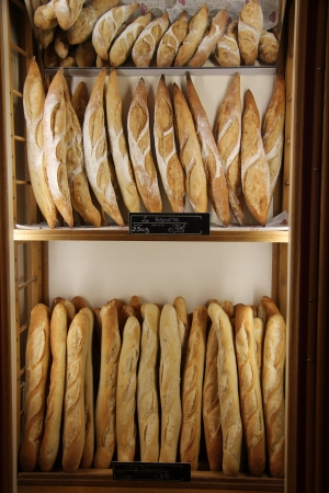 Baguettes, Typical French sorts of bread at a shop in France Stock Photo - 15269321