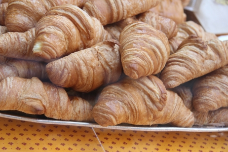 Fresh croissants on display in a french shop photo