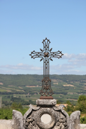 Cast iron cross ornament at an old cemetery in the provence photo